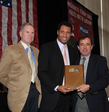 William Gaine, the MIAA Deputy Director (left) and Steve Burton of WBZ-TV (center) present Dave McGillivray, president of DMSE Sports, Inc., with the 2010 Ron Burton Community Service Award.