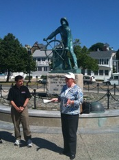 Gloucester Mayor Carolyn Kirk and DMSE President Dave McGillivray at the famous Gloucester Fisherman's Memorial Statue, the start/finish of the new Run Gloucester! 7-Mile Road Race on Aug. 22.