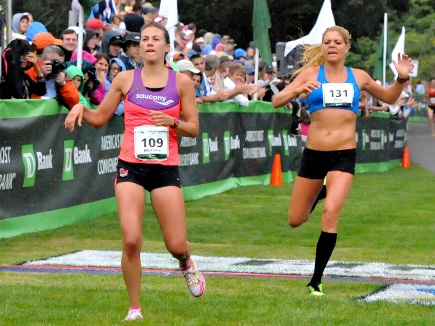 Erica Jesserman, right, and Michelle Lillenthal at finish line of 2013 race. This year, Lillenthal is a Maine Resident.