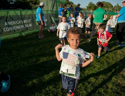 Kids of all age experience the joy of running each year at the Kids Fun Run on the Friday night before the race.