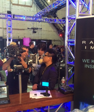 Michael Mansouri discusses filmmaking gear with Matthew Libatique, ASC, in Radiant Images booth at 2014 Cine Gear.