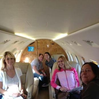 Grand prize winners in the first-ever Maine Suitcase Party inside Maine Aviation's Hawker 1000 jet before return trip to Portland from NYC weekend.